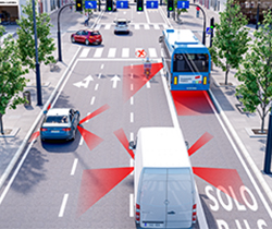 Imagen de una calle con varios carriles y vehículos y en uno de ellos un motorista delante de ellos